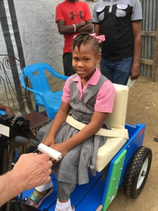 New cart helps girl get around.